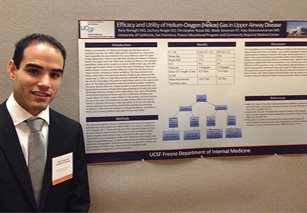 Resident presenting poster at conference
