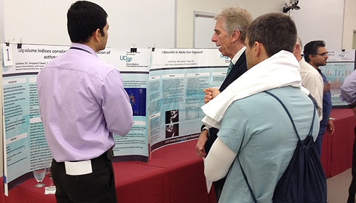 Residents discussing research poster projects