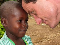 Doctor with child in Ghana