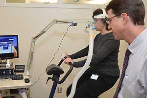 Faculty  testing patient on exercise bike