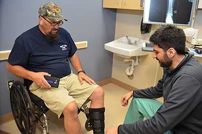 Resident attending patient in wheelchair