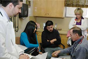 Faculty and resident consulting with family