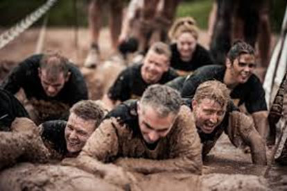 going through the mud in an obstacle course