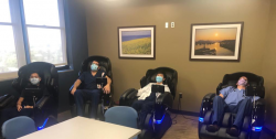 residents sitting in massage chairs