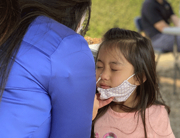 A young girl is tested at a mobile event
