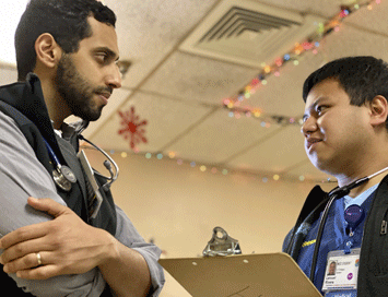 Emergency Medicine resident and UCSF School of Medicine graduate Walid Hamud-Ahmed, MD, and UCSF SJV PRIME student Limuel Rivera at a Mobile HeaL clinic