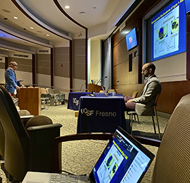 A cardiology fellow facilitates while John Ambrose, MD, emeritus chief, UCSF Fresno Cardiology, presents during the virtual symposium
